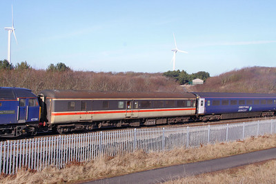 Mk2e BSO 9496 heads north past Siddick between Workington & Flimby 02/03/10  9496 is operated by HSBC Rail