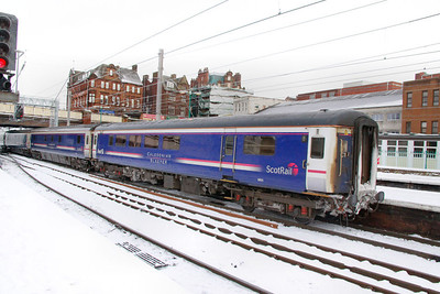 Mk2e BUO 9801 departs Carlisle in the snow 03/12/10  9801 was converted from Mk2e TSO 5760