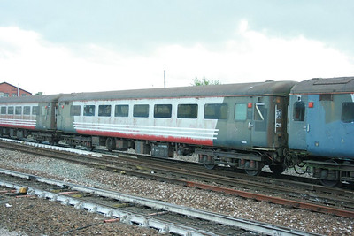 Mk2f TSO 6002 in heavily faded Virgin livery departs Exeter St Davids on the: 5Z31 13:15 Yeovil Junction to Okehampton. 24/09/12  The coach had been stored at Yeovil Junction from 2008-2012 outdoors and was transferring to the Dartmoor Railway