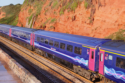 40116 heads north along the Dawlish Sea Wall passing Rockstone Bridge 11/09/09  40116 was converted from TS 42147