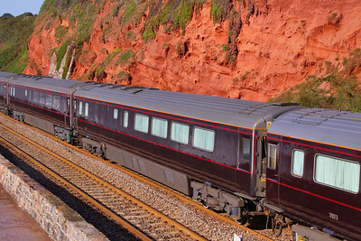 "2916 ""The Prince of Wales's Dining Car"" heads north along the Dawlish Sea Wall passing Rockstone Bridge 11/09/09  2916 was coverted from HST Mk3 TRUK 40512 and is now fitted with a central table for 14 people and the large kitchen retained"