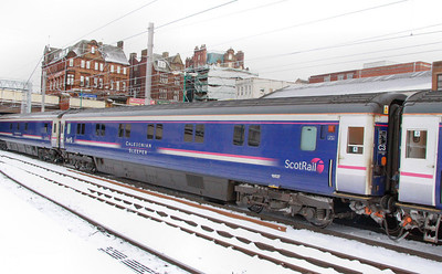10527 departs Carlisle in the snow 03/12/10
