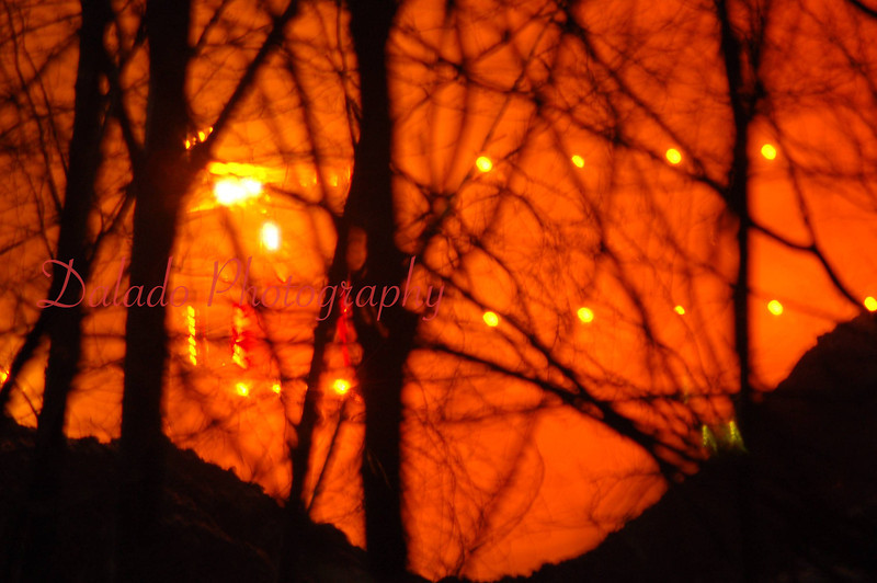 "(December of 2006) Excelsior ""Mulch"" Fire- This photo shows a truck surrounded by smoke."