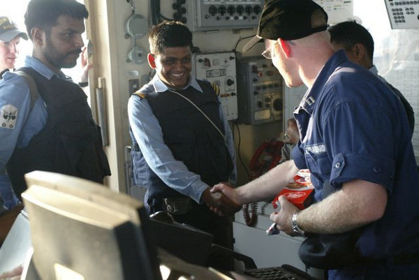 Boarding officers from the ICGS SAMAR are welcomed aboard USCGC MIDGETT for joint law enforcement training. Boarding teams from both vessels shared tactics and procedures for conducting maritime boardings in a high risk environment.