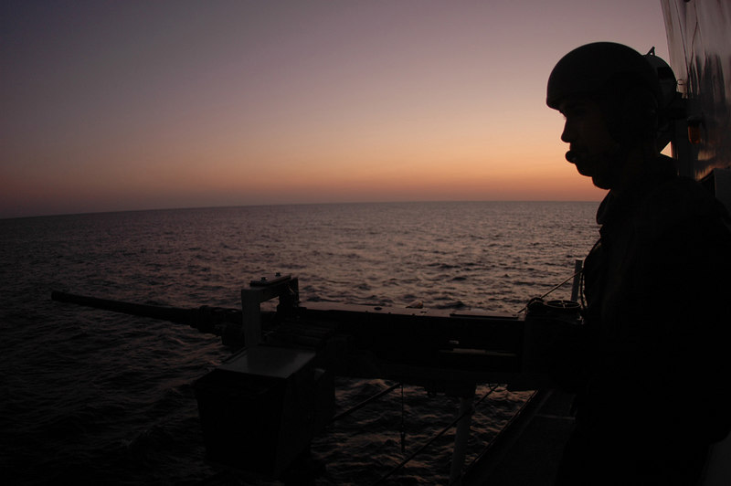ABOARD CGC MIDGETT (Dec 10, 2006) Petty Officer 3rd Class Jason Lothrop stands an early morning watch on the decks of the CGC Midgett while underway in the Indian Ocean, Dec 10, 2006.  Midgett, a 378-foot High Endurance cutter homeported in Seattle is currently deployed in the Indian Ocean in support of Operation Enduring Freedom.  U.S. Coast Guard Photo by Petty Officer 2nd Class Mariana OÕLeary.
