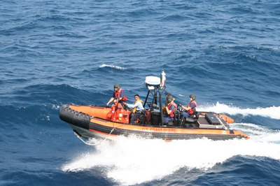 Boat coxswains from the ICGS SAMAR conduct joint training on small boat operations with a MIDGETT boat crew.