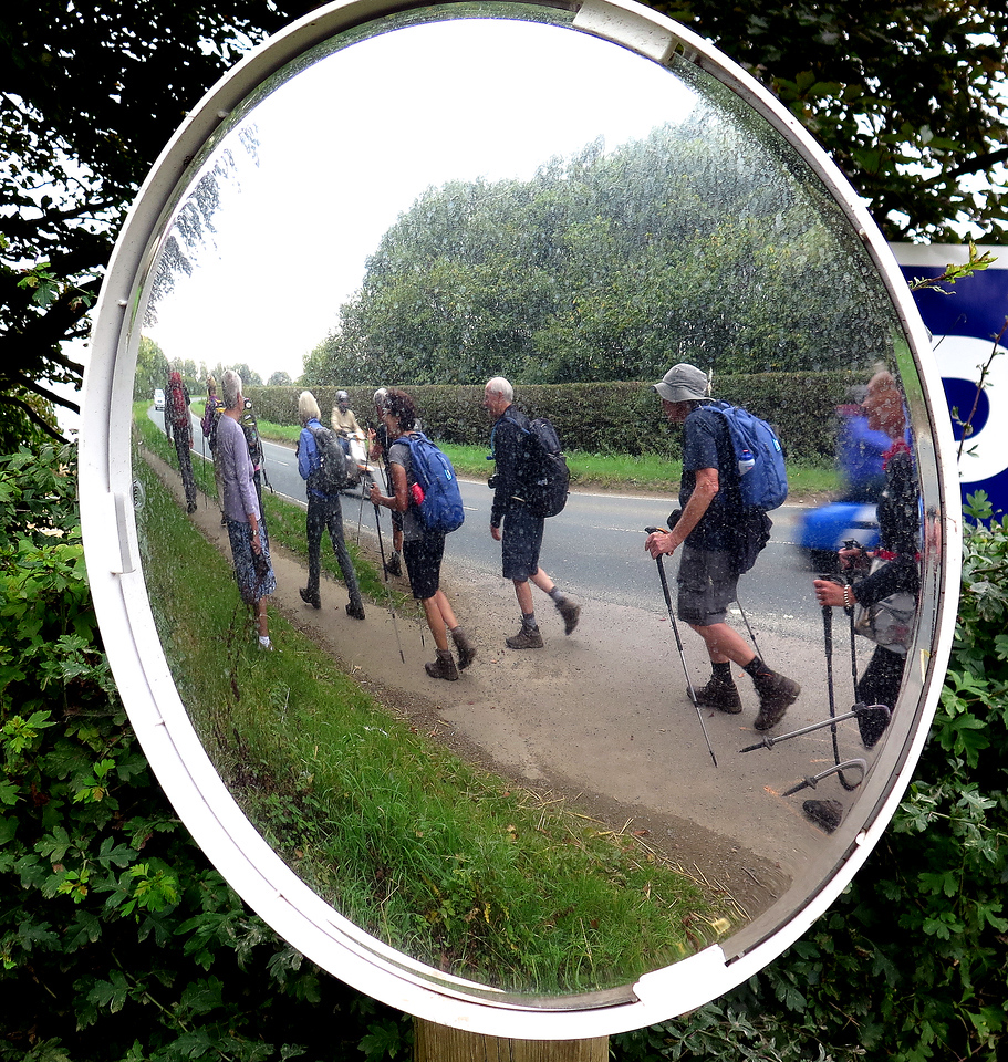 The group plods on alongside the road - How does Loz get her sticks to do that?