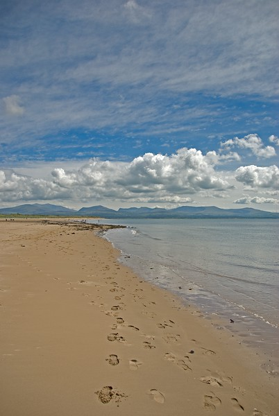 Llanddwyn Bay, towards Snowdonia, Wales.