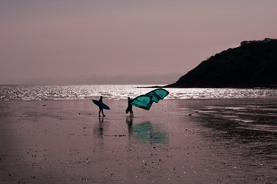 Surfer and windsurfer at Oxwich