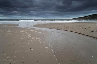 Stream crosses beach North Shore Cape Breton Island Nova Scotia Gulf of St. Lawrence