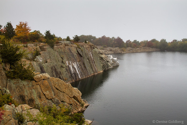 the edges of a water-filled quarry on a very gray day