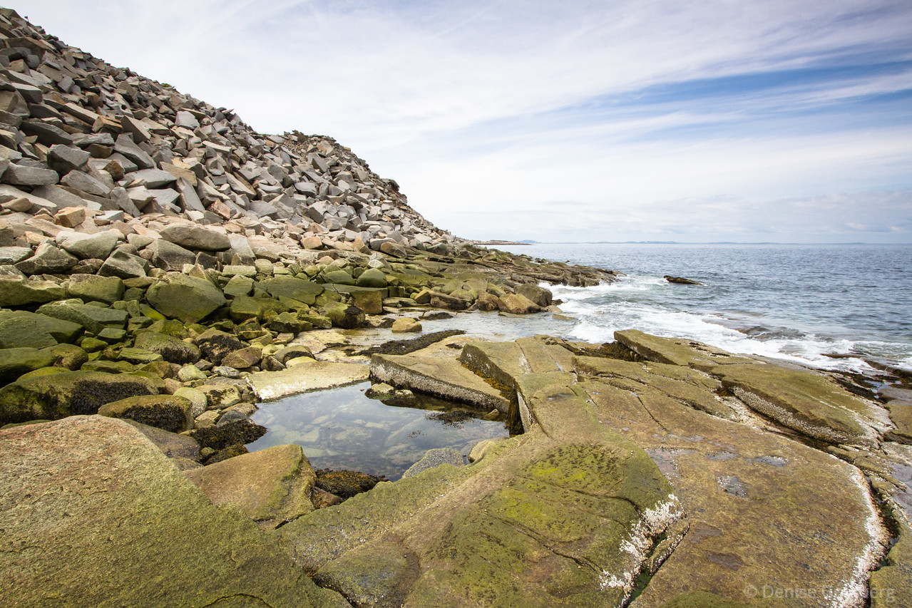 quarried rocks and ocean