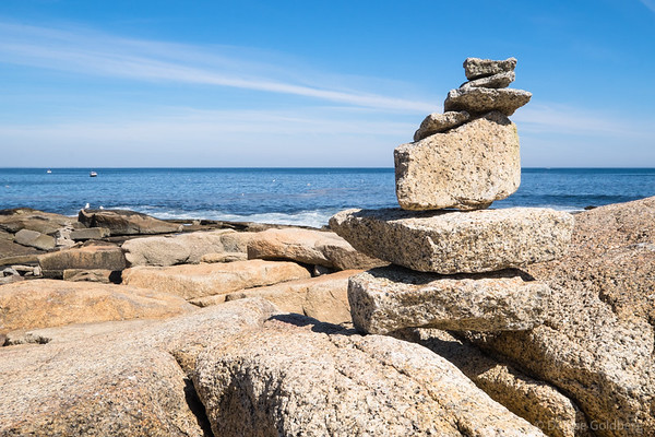 a stack of rocks along a rocky coastline