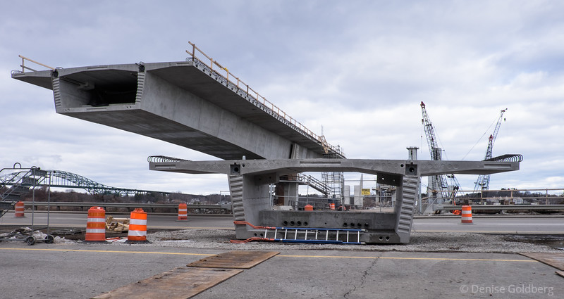 a section of the new bridge on the ground, waiting for installation