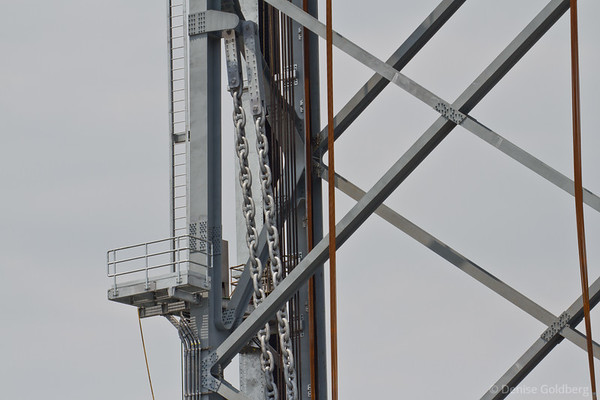 center span raised, counterweight chains bearing weight on the side of the tower