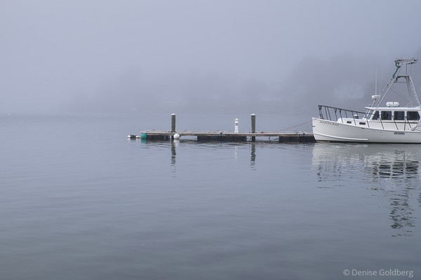 a boat stands out on a foggy day