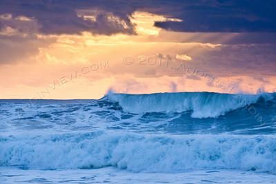 Orange sky, breaking wave