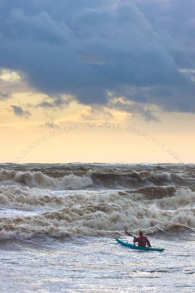 Kayaker in rough seas