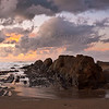 Striped rocks, dark clouds