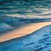shoreline on the beach at sunset