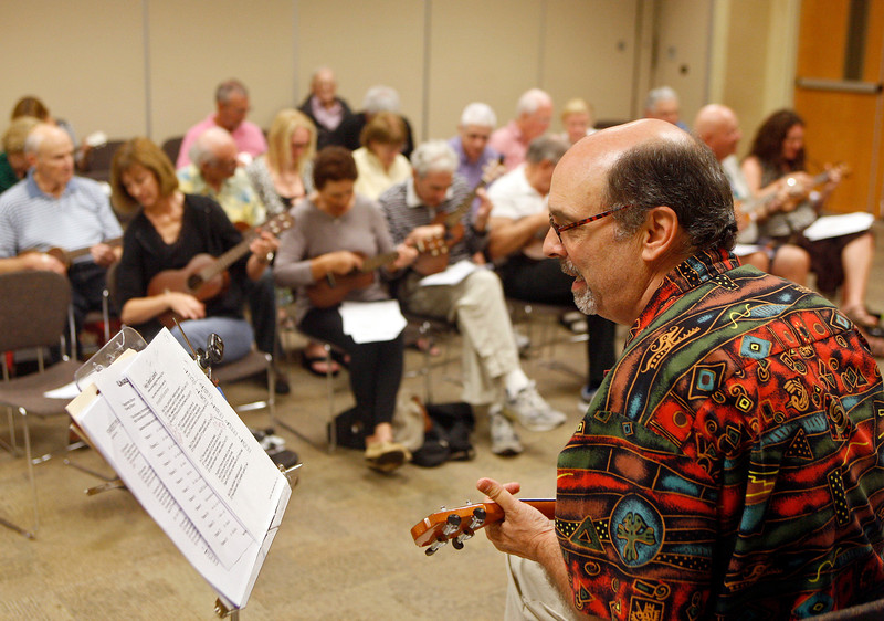 "011414 - DELRAY BEACH  - Tavit Smith, a retired Delray Beach psychotherapist and ukulele player held his first Ukulele Get-Together, for players of all abilities on Jan. 14 at the Delray Beach Public Library. Pictured is Tavit Smith instructing 30 ukuleles players during the first ""Ukulele Get-Together"" of 2014.  Photo by Tim Stepien/The Coastal Star"