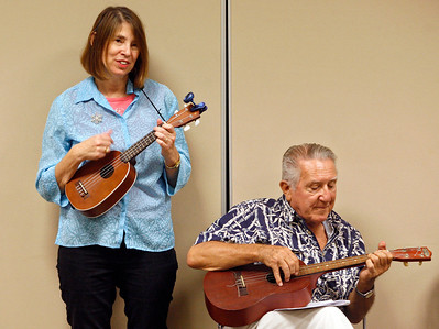 "011414 - DELRAY BEACH  - Tavit Smith, a retired Delray Beach psychotherapist and ukulele player held his first Ukulele Get-Together, for players of all abilities on Jan. 14 at the Delray Beach Public Library. Lynn Smith, wife of Tavit Smith, and Delray resident Lou Ruffino strum their ukuleles during the Delray Beach Public Library  ""Ukulele Get-Together"".  Photo by Tim Stepien/The Coastal Star"