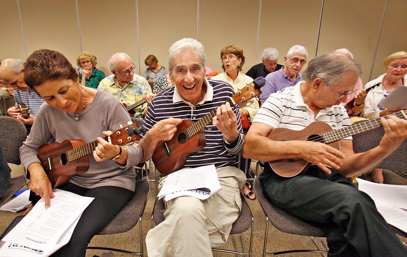 011414 - DELRAY BEACH  - Tavit Smith, a retired Delray Beach psychotherapist and ukulele player held his first Ukulele Get-Together, for players of all abilities on Jan. 14 at the Delray Beach Public Library. Pictured center is Delray Beach resident Bob Papell having a blast playing his ukulele. Photo by Tim Stepien/The Coastal Star