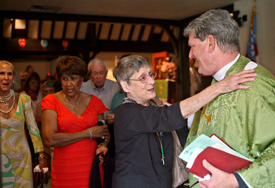 "The Rev. William ""Chip"" Stokes of St. Paul 's Episcopal Church  is given a warm goodbye by Barbara Powell after his last mass at St. Paul 's on Sunday, July 14th, 2013. Barbara Powell is a resident of Whiting, New Jersey (inside The Diocese of New Jersey).  Barbara splits her time in Whiting and Boynton Beach Florida where she lives six-months also.   ""Chip"" Stokes will be ordained as bishop on Nov. 2. as The Bishop of The Diocese of New Jersey. Photo by Tim Stepien"