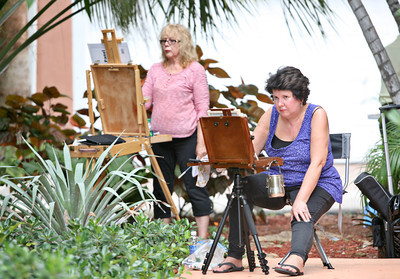 072013 - DELRAY BEACH -(R to L) Boynton Beach resident Susan Blair Smith and Diane Jasmine of Deerfield Beach paint during a plein air session outside of PapaGallery Studio in Delray Beach. This meetup group is for art lovers and artists at all levels who love plein air painting in and around Palm Beach County and the surrounding south Florida vicinity. They have over 120 members and usually have anywhere from 5 to 20 artists participating in their scheduled plein air meetups. The group was organized by Ralph Papa in 2010 to bring artists together to paint the land, sea and city scapes in beautiful south Florida. Photo by Tim Stepien
