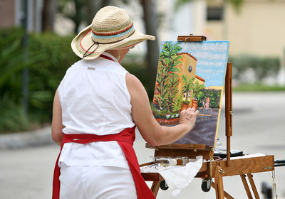 072013 - DELRAY BEACH - Boynton resident Diane Hagg paints a street scene during a plein air painting  session at PapaGallery Studio in Delray Beach. The plein air meet up group is for art lovers and artists at all levels who love plein air painting in and around Palm Beach County and the surrounding south Florida vicinity. They have over 120 members and usually have anywhere from 5 to 20 artists participating in their scheduled plein air meetups. The group was organized by Ralph Papa in 2010 to bring artists together to paint the land, sea and city scapes in beautiful south Florida. Photo by Tim Stepien
