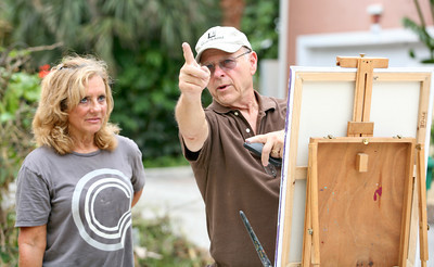 072013 - DELRAY BEACH - Pictured at right, Ralph Papa gives painting tips to Boca resident Trish Kahn. Papa is a local artist and organizer of the plein air session painting session at PapaGallery Studio in Delray Beach. The group was organized by Ralph Papa in 2010 to bring artists together to paint the land, sea and city scapes in beautiful south Florida. The plein air meet up group is for art lovers and artists at all levels who love plein air painting in and around Palm Beach County and the surrounding south Florida vicinity. They have over 120 members and usually have anywhere from 5 to 20 artists participating in their scheduled plein air meetups. Photo by Tim Stepien