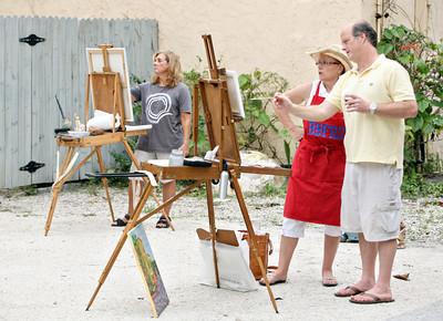 072013 - DELRAY BEACH - Pictured at right, Brennan King gives painting tips to Boynton resident Diane Hagg. Brennan is a local artist and co-organizer of the plein air session painting session at PapaGallery Studio in Delray Beach. The plein air meet up group is for art lovers and artists at all levels who love plein air painting in and around Palm Beach County and the surrounding south Florida vicinity. They have over 120 members and usually have anywhere from 5 to 20 artists participating in their scheduled plein air meetups. The group was organized by Ralph Papa in 2010 to bring artists together to paint the land, sea and city scapes in beautiful south Florida. Photo by Tim Stepien