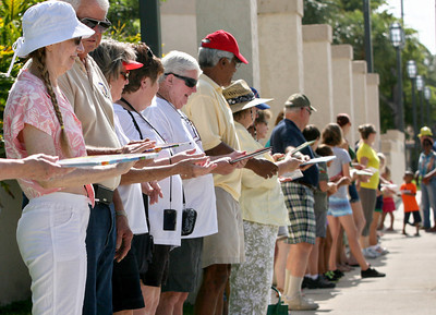 062013 - BOCA RATON - On Thursday morning, more than 300 people showed up to move Boca Raton's old Downtown Library's last 100 books person by person into the new library. The group formed a human chain that spanned the two-block distance between the old library's front door and the new one.  Photo by Tim Stepien