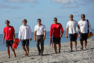 061413 - DELRAY BEACH - From left to right: Ocean Rescue Officers Justin Rumbaugh and Justin Walton, Superintendent James Scala, Ocean Rescue Officers Raphael Costa and Kyle Stewart, and Lieutenant Luigi Pratt. Photo by Tim Stepien