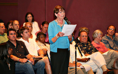 060613 - DELRAY BEACH -  Downtown Development Authority Executive Director Marjorie Ferrer addresses  Delray Beach Mayor Cary Glickstein and city commissioners in front of a crowd of more than 300 people who attended the Delray Beach Town Hall Meeting Thursday evening at the Crest Theatre at Old School Square.  Marjorie was voicing her concerns about community safety, lighting and security in the downtown area. Please let me know if you need any additional caption information, the audio can be heard at  http://mydelraybeach.com/city-commission/town-hall-meetings.   Photo by Tim Stepien