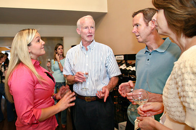 """061313 - DELRAY BEACH -  Once """"Old Vines"""",  the wine shop at 900 Atlantic Ave. in Delray Beach became """"The Wine Wave"""" on June 5. (L to R) Lindsey Gasparini, 27, one of the owners of  """"The Wine Wave"""",  talks wine with previous owner of """"Old Vines"""",  David Spitzer and Delray Beach residents Eric Gebhard and Michele Palenscar .  Photo by Tim Stepien"""