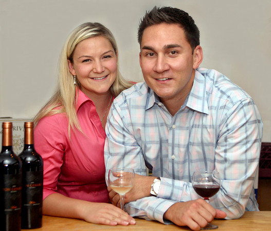 "061313 - DELRAY BEACH - Lindsey Gasparini, 27  and her partner Jeremiah Flores, 29 photographed Thursday at their newly aquired and renamed business ""The Wine Wave"".  Once ""Old Vines"",  the wine shop at 900 Atlantic Ave. in Delray Beach became The Wine Wave on June 5. Photo by Tim Stepien"