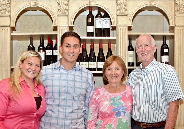 "061313 - DELRAY BEACH -  Once ""Old Vines"",  the wine shop at 900 Atlantic Ave. in Delray Beach became ""The Wine Wave"" on June 5. Pictured at left are owners of ""The Wine Wave"", Lindsey Gasparini, 27  and her partner Jeremiah Flores, 29, photographed  with the previous owner of ""Old Vines"",  David Spitzer and his wife Sue.  Photo by Tim Stepien"