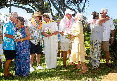 """030914 - OCEAN RIDGE - On March 9 at 4 pm, four couples who live in Colonial Ridge Club in Ocean Ridge celebrated their 50th wedding anniversaries at a ceremony at the condo's gazebo on the beach. They billed the event as """"200 years of love.""""  Pictured left to right,  John and Bea Fearon, Mary Lou and Steve Cousley, Marie and David Vladka, and Bob and Jeri Bove. Photo by Tim Stepien"""