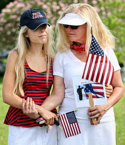 052713 - BOCA RATON - Boca residents, mother and daughter, Rebecca and Marena Restivo, 20, (r to l), share a tender moment during the Memorial Day Observance held Monday morning at the Boca Raton City cemetery. Rebecca lost her brother Christopher Richard Seitz, US Army, in 1972 during the war in Vietnam. Christopher was only 20 years old at the time, the same age as Marena. The Participating groups included American Legion Post #277 and its auxiliary unit, Boca Raton Elks Lodge #2166, Boca Raton Community High School unit of the Navy Junior ROTC under the direction of Commander Ken Bingham, Boca Raton Community High School Band under the direction of Jenn Mimmino, Fort Lauderdale Highlanders, and honor guard units representing the City's Police Services and Fire/Rescue Services..  Photo by Tim Stepien
