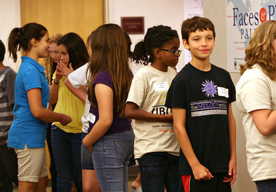 "051313 - WPB - Devin Dykstra, right, waits to take the stage during rehearsal Monday evening.  Devin and his brother Blake are just two of the more than 350 most talented voices in the area spanning ages 8 – 18 who performed on the main stage of the Kravis Center with Palm Beach County's award winning community chorus on May 19th for the organization's 10th Anniversary performance, ""Ubuntu."" Photo by Tim Stepien"