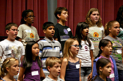 "051313 - WPB - Devin Dykstra, top center, sings during rehearsal Monday evening.  Devin and his brother Blake are just two of the more than 350 most talented voices in the area spanning ages 8 – 18 who performed on the main stage of the Kravis Center with Palm Beach County's award winning community chorus on May 19th for the organization's 10th Anniversary performance, ""Ubuntu."" Photo by Tim Stepien"