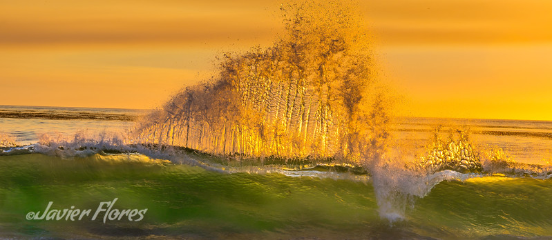 Panoramic of Surf crashing at sunset