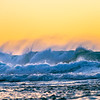 Surf crashing at sunset