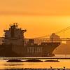 Ship Heading to Sea at Sunset