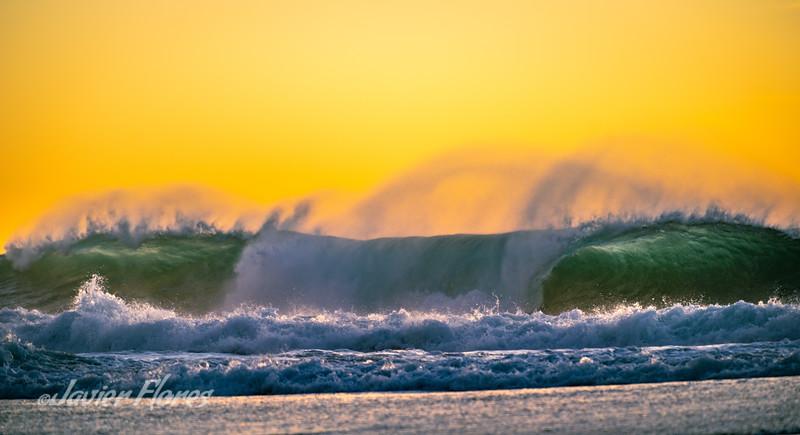 Surf crashing at sunset