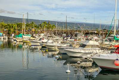 Honokohau Harbor with snow on Mauna Loa