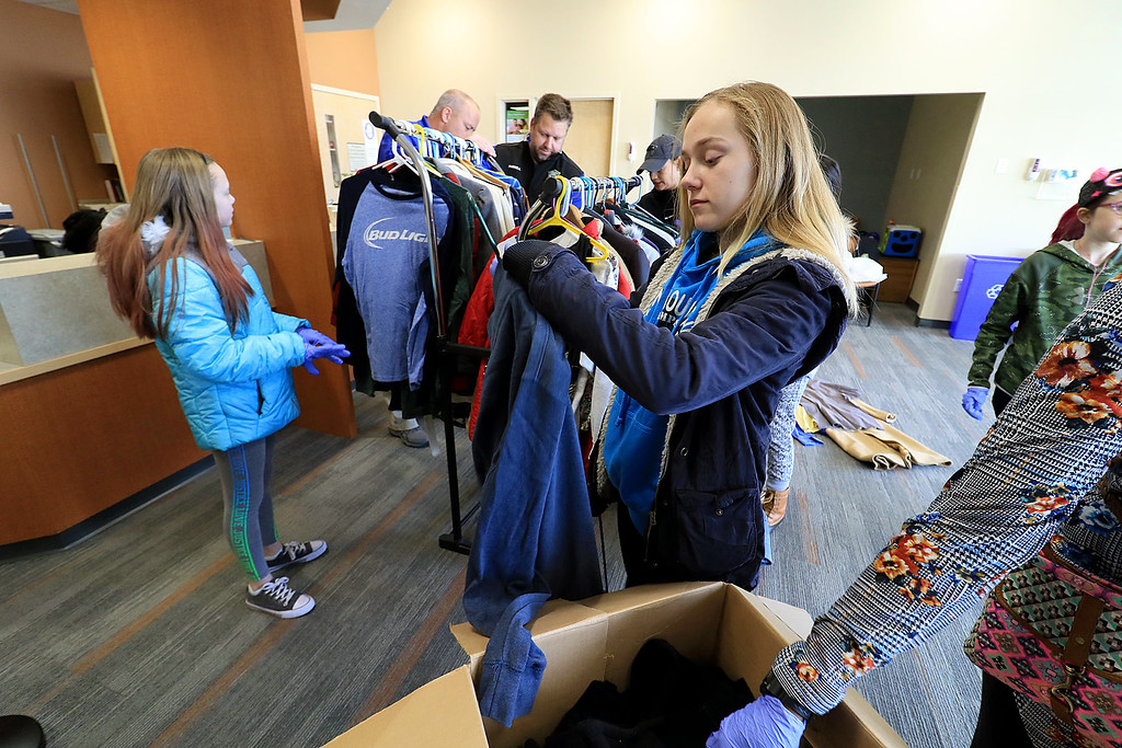 . The Fitchburg Police Department held a coat drive at Community Health Connections on Saturday morning, November 17, 2018. Girl Scout Troop 30713 was on hand to help fold and organize all of the clothes they got donated. Girl Scout Elizabeth Kidd, 13, organizes the donated clothes. SENTINEL & ENTERPRISE/JOHN LOVE