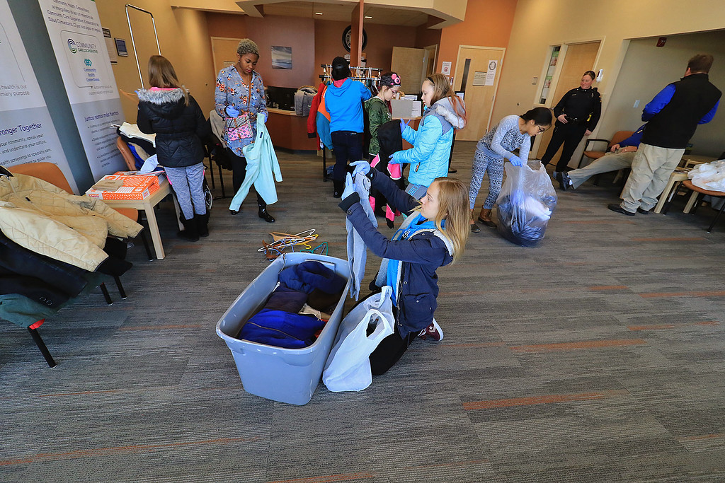 . The Fitchburg Police Department held a coat drive at Community Health Connections on Saturday morning, November 17, 2018. Girl Scout Troop 30713 was on hand to help fold and organize all of the clothes they got donated. SENTINEL & ENTERPRISE/JOHN LOVE