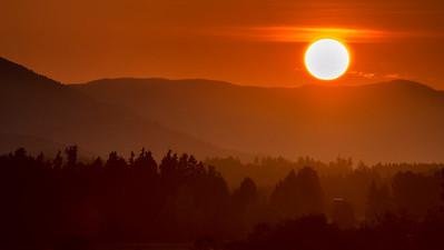 Hazy sunset over Cobble Hill landscape